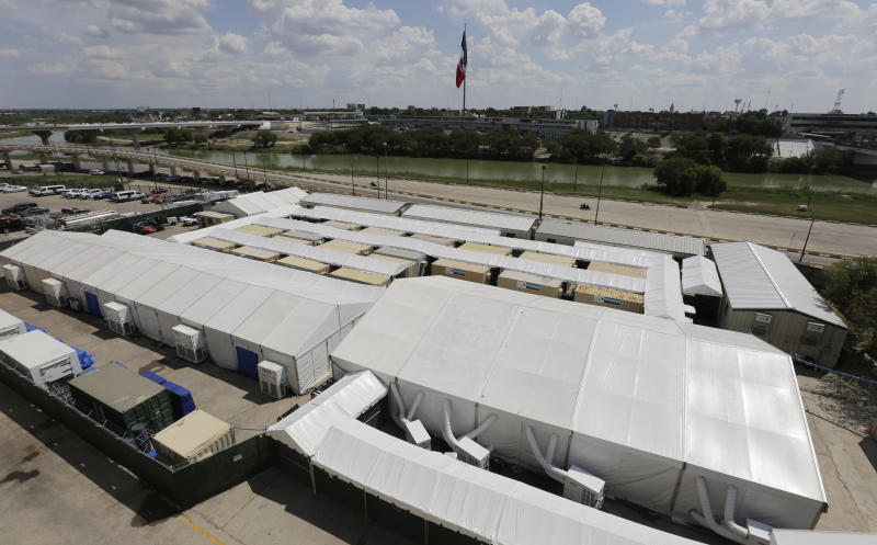 The Migration Protection Protocols Immigration Hearing Facility, a new tent court facility made up of tents and portable pods, Tuesday, Sept. 17, 2019, along the Rio Grande in Laredo, Texas. (AP Photo/Eric Gay)