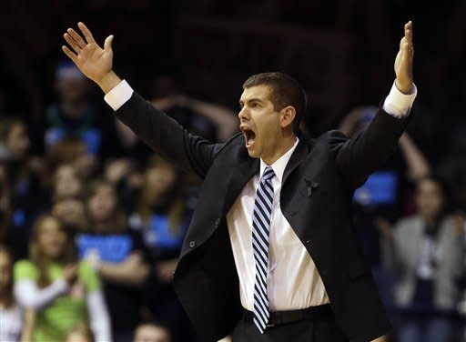 Butler head coach Brad Stevens questions a call in the first half of an NCAA college basketball game against Rhode Island in Indianapolis, Saturday, Feb. 2, 2013. (AP Photo/Michael Conroy)