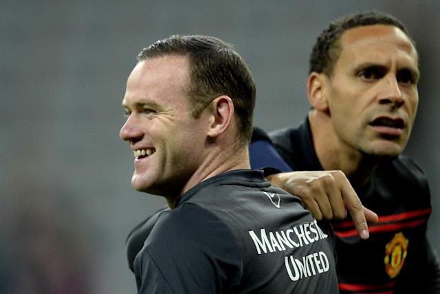 Wayne Rooney (left) and Rio Ferdinand warm up before Manchester United's Champions League quarter-final second leg game against Bayern Munich in Munich on April 9, 2014 (AFP Photo/Johannes Eisele)