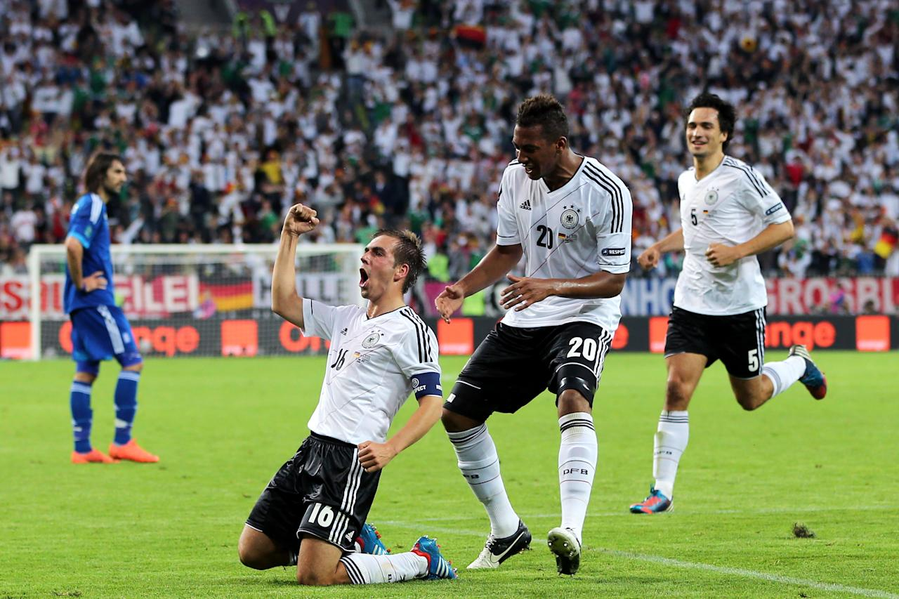 GDANSK, POLAND - JUNE 22:  Philipp Lahm of Germany celebrates scoring their first goal with Jerome Boateng during the UEFA EURO 2012 quarter final match between Germany and Greece at The Municipal Stadium on June 22, 2012 in Gdansk, Poland.  (Photo by Alex Grimm/Getty Images)
