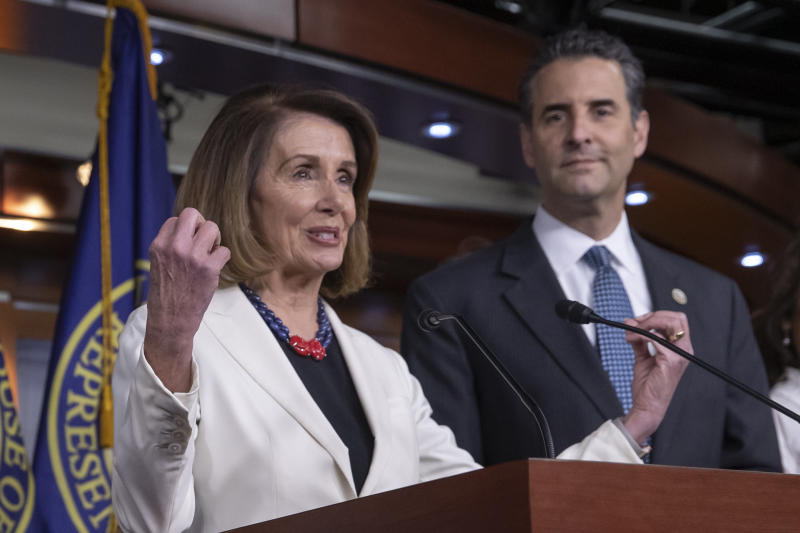 Speaker Nancy Pelosi (D-Calif.) and Rep. John Sarbanes (D-Md.) discuss the For the People Act at a news conference on Nov. 18. (J. Scott Applewhite/ASSOCIATED PRESS)