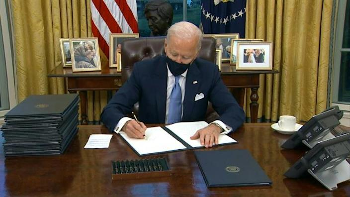 Biden signs series of orders, including to rejoin Paris climate accords