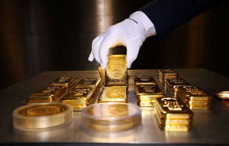 Gold hits record, equities edge higher on stimulus hopes