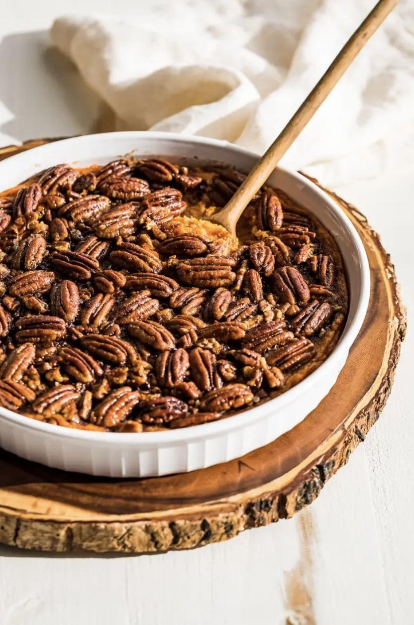 """<p>Enjoy a sweet potato casserole sans refined sugars, gluten, and dairy when you whip up this delicious side dish. Topped with caramelized pecans and filled with creamy mashed potatoes, every bite will make your taste buds swoon with delight.</p> <p><strong>Get the recipe</strong>: <a href=""""https://getinspiredeveryday.com/food/paleo-sweet-potato-casserole/"""" class=""""link rapid-noclick-resp"""" rel=""""nofollow noopener"""" target=""""_blank"""" data-ylk=""""slk:paleo sweet potato casserole"""">paleo sweet potato casserole</a></p>"""