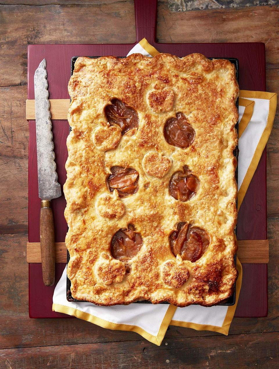 """<p>Feeding a crowd? This impressive-looking centerpiece dessert guarantees everyone gets a slice.</p><p><strong><a href=""""https://www.countryliving.com/food-drinks/a34275052/salted-caramel-apple-slab-pie-recipe/"""" rel=""""nofollow noopener"""" target=""""_blank"""" data-ylk=""""slk:Get the recipe"""" class=""""link rapid-noclick-resp"""">Get the recipe</a>.</strong> </p>"""