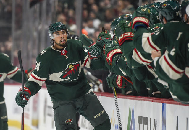 Minnesota Wild defenseman Mathew Dumba celebrates with the bench after scoring a goal against the Vegas Golden Knights in the first period during an NHL hockey game Saturday, Oct. 6, 2018, in St. Paul, Minn. (AP Photo/Craig Lassig)