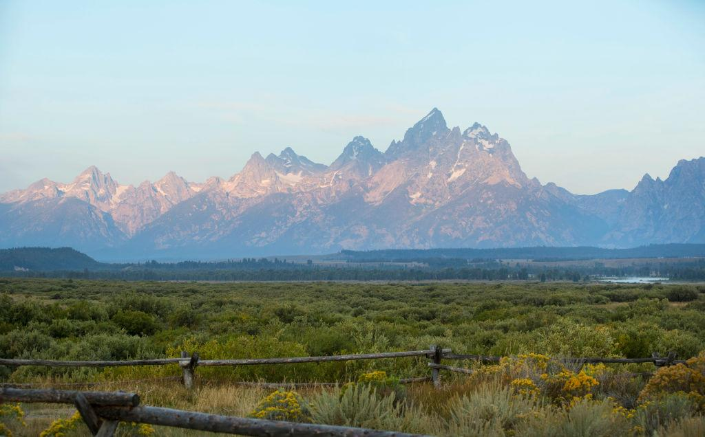 """<p>Stay at <a rel=""""nofollow"""" href=""""http://www.alpinehouse.com/#gref"""">The Alpine House Lodge and Cottages</a> (it's close to Grand Teton National Park), or <a rel=""""nofollow"""" href=""""https://www.airbnb.com/s/Jackson--WY?type=cabin&listing_types%5B%5D=4&s_tag=21JuOur8&allow_override%5B%5D="""">rent a cabin of your own on Airbnb</a>. </p>"""