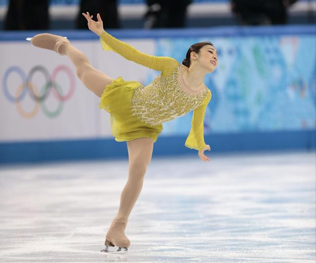Yuna Kim of South Korea competes in the women's short program figure skating competition at the Iceberg Skating Palace during the 2014 Winter Olympics, Wednesday, Feb. 19, 2014, in Sochi, Russia. (AP Photo/Ivan Sekretarev)