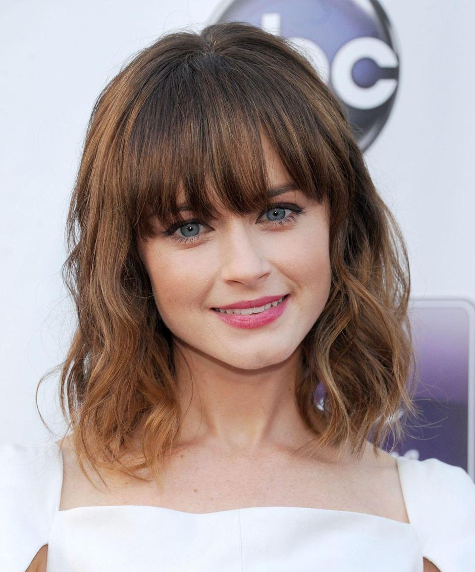 """<p>Long, straight bangs will never go out of style, especially because they're so versatile. You can wear them blunt, piece-y, parted, swept to the side, off the face — you name it.</p><p><strong>RELATED: </strong><a href=""""https://www.goodhousekeeping.com/beauty/hair/g2542/best-haircuts-ever/"""" rel=""""nofollow noopener"""" target=""""_blank"""" data-ylk=""""slk:23 Timeless Hairstyles That Will Always Be Trendy"""" class=""""link rapid-noclick-resp"""">23 Timeless Hairstyles That Will Always Be Trendy</a></p>"""