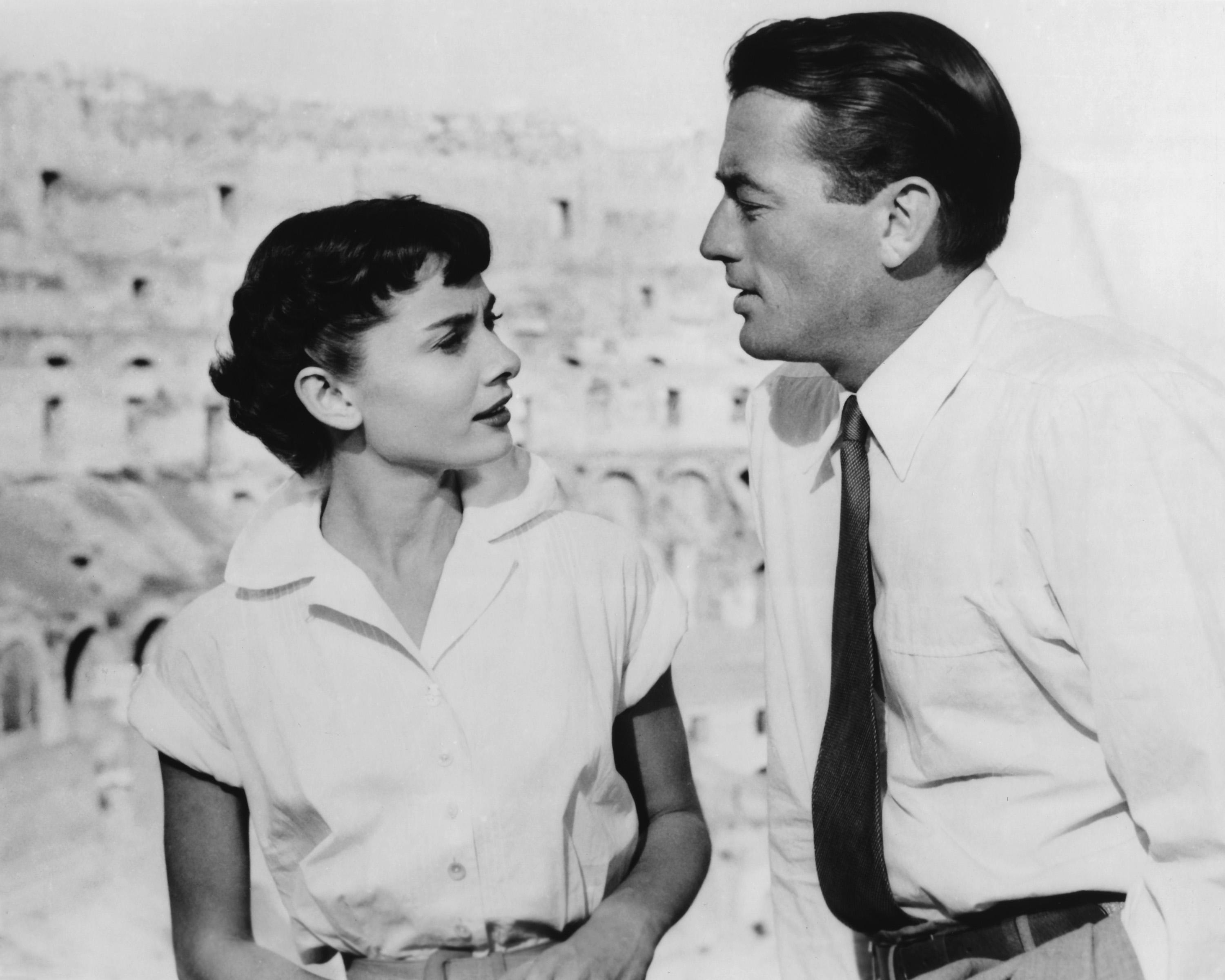 Actors Gregory Peck as Joe Bradley and Audrey Hepburn as Princess Ann in the film 'Roman Holiday', 1953. Here they visit the Colosseum in Rome together. (Photo by Silver Screen Collection/Getty Images)