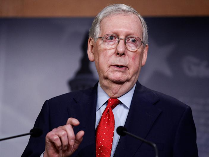 FILE PHOTO: U.S. Senate Majority Leader Mitch McConnell (R-KY) speaks to reporters after it was announced U.S. congressional leaders and the White House agreed on nearly $500 billion more in coronavirus relief for the U.S. economy, bringing to nearly $3 trillion the amount allocated to deal with the crisis, on Capitol Hill in Washington, U.S., April 21, 2020. REUTERS