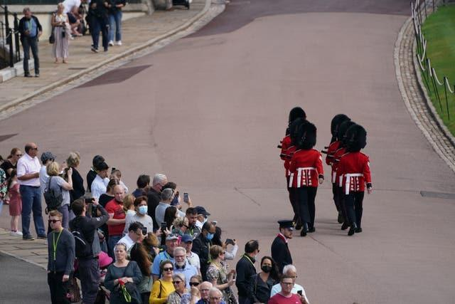 Members of the public watch the Guard Change