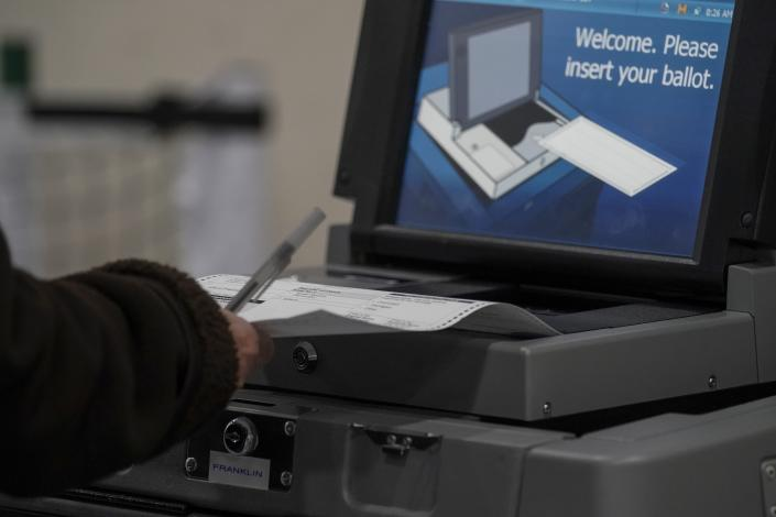A voter casts their ballot on Election Day, at the Milwaukee County Sports Complex Tuesday, Nov. 3, 2020, in Franklin, Wis. (Morry Gash/AP)