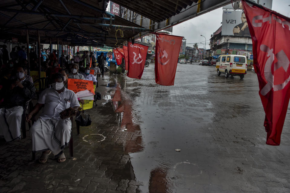 An ambulance rides through a deserted street as left party activists attend a meeting in support of nation-wide shutdown to protest against the contentious farm laws in Kochi, Kerala state, India, Monday, Sept.27, 2021. (AP Photo/R S Iyer)