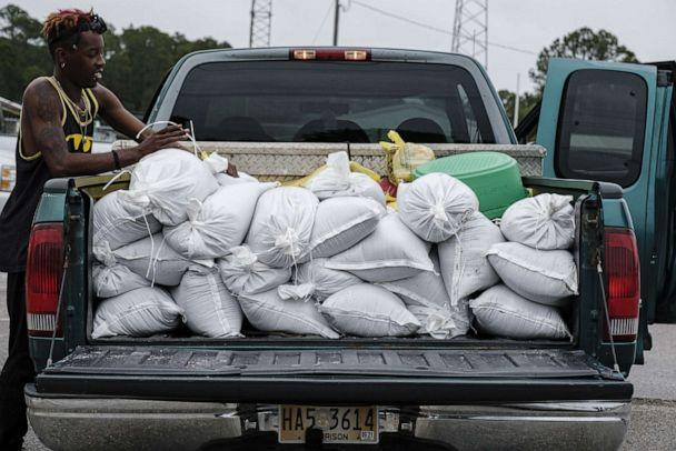 PHOTO: Daquan Hamis loads sandbags into the back of a truck as Hurricane Zeta approaches in Gulfport, Miss., Oct. 2020. (Dan Anderson/EPA via Shutterstock)