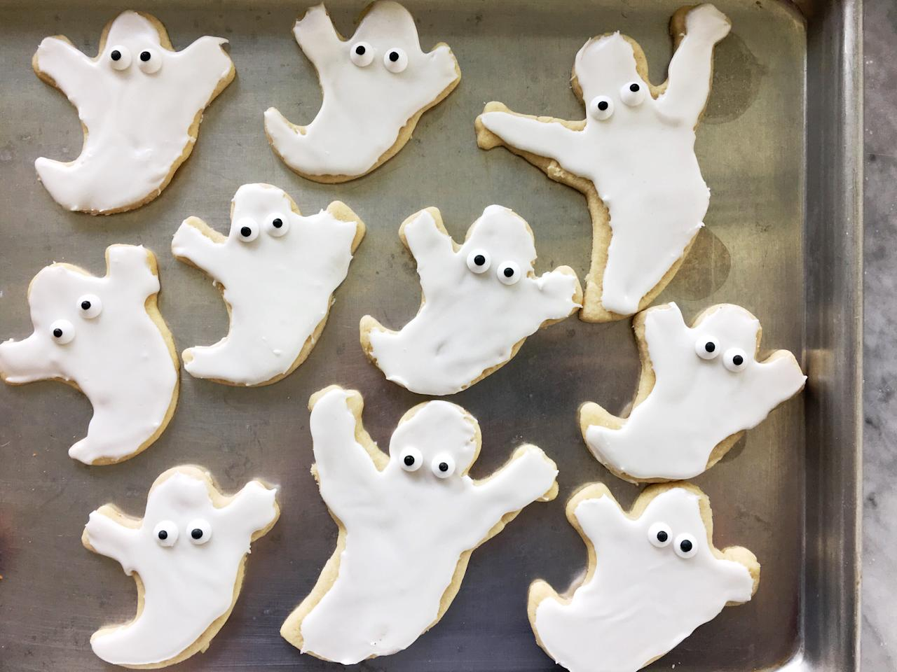 """<p>Prepare for a sweet scare when these adorable Halloween ghost cookies are all iced, decorated, and ready to party. Super easy and<a href=""""https://www.myrecipes.com/how-to/halloween-ideas-for-kids""""> kid-friendly to make</a>, these butter cut-out cookies coated with royal icing are the perfect dessert for <a href=""""https://www.myrecipes.com/holidays-and-occasions/halloween-recipes/halloween-party-food-ideas"""">your Halloween spread</a>. Candy eyeballs add a playful, whimsical touch to these <a href=""""https://www.myrecipes.com/holidays-and-occasions/halloween-recipes/halloween-treat-recipes"""">spooky treats</a>, but you could also use black icing to draw eyes on your ghost cookies. Using a classic <a href=""""https://www.myrecipes.com/recipe/cut-out-butter-cookies"""">cut-out butter cookie dough</a> keeps the edges of your ghost cookies shape neat and clean—no worries about the cookies expanding when they bake. Whip up a batch with the kids and let them go to town with the decorating for a fun Halloween kitchen activity.</p> <p><a href=""""https://www.myrecipes.com/recipe/ghost-cookies"""">Ghost Cookies Recipe</a></p>"""
