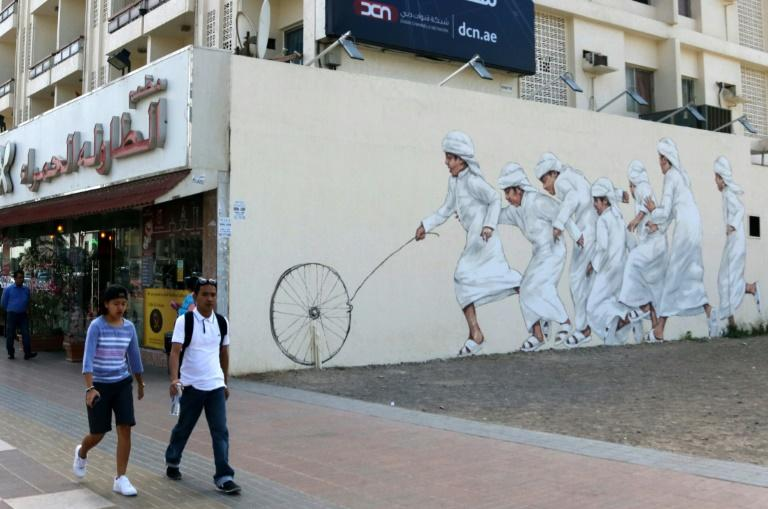 A graffiti by Malaysian-based Lithuanian artist Ernest Zacharevic, seen on a wall of 2nd of December street, part of the government-funded Dubai Street Museum project