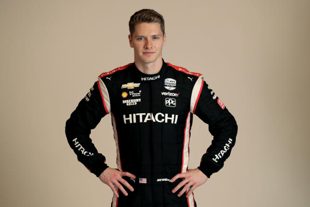 FILE - In this Feb. 10, 2020, file photo, IndyCar driver Josef Newgarden poses for photos during IndyCar Media Day in Austin, Texas. The IndyCar season starts with the Grand Prix of St. Petersburg on Sunday, March 15, 2020. (AP Photo/Eric Gay, File)