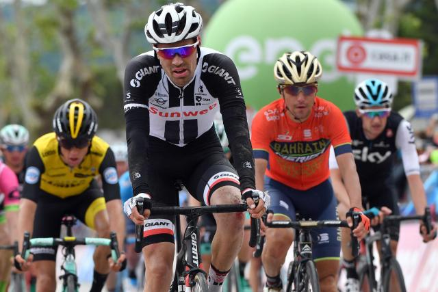 Dutch rider Tom Dumoulin crosses the finish line too complete the 10th stage of the Giro d'Italia cycling race, from Penne to Gualdo Tadino d'Italia, Italy, Tuesday, May 15, 2018. Overall leader Simon Yates gained three bonus seconds in the 10th stage of the Giro d'Italia but it was a difficult day for his Mitchelton-Scott team as Esteban Chaves dropped out of contention. (Daniel Dal Zennaro/ANSA via AP)