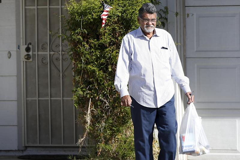 Syed Farook, father of San Bernardino shooting suspect Syed Rizwan Farook, leaves a residence in Riverside
