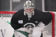 Dallas Stars goaltender Ben Bishop (30) defends the goal during an NHL hockey practice in Frisco, Texas, Thursday, Sept. 23, 2021. (AP Photo/LM Otero)