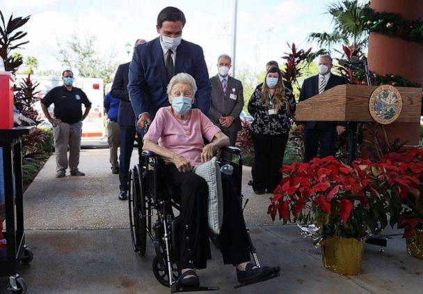PHOTO: Florida Gov. Ron DeSantis pushes Vera Leip, 88, in her wheelchair after she received a Pfizer-BioNtech COVID-19 vaccine at the John Knox Village Continuing Care Retirement Community, Dec. 16, 2020, in Pompano Beach, Florida. (Joe Raedle/Getty Images)