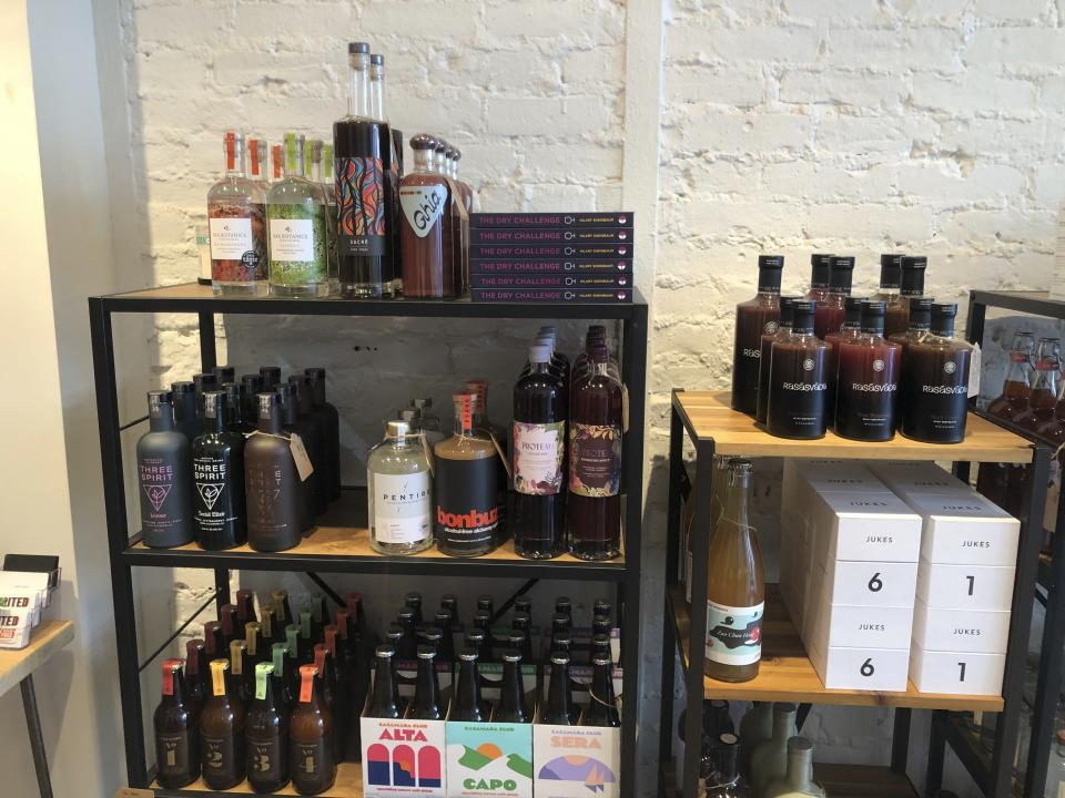 """This March 4, 2021 photo shows alcohol-free spirits for sale at Spirited Away, New York's first """"booze-free bottle shop."""" According to IWSR Drinks Market Analysis, global consumption of zero-proof beer, wine and spirits is growing two to three times faster than overall alcohol consumption.(AP Photo/Joseph B. Frederick)"""