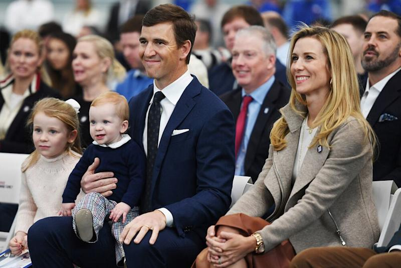 Eli Manning with his wife and children | Sarah Stier/Getty