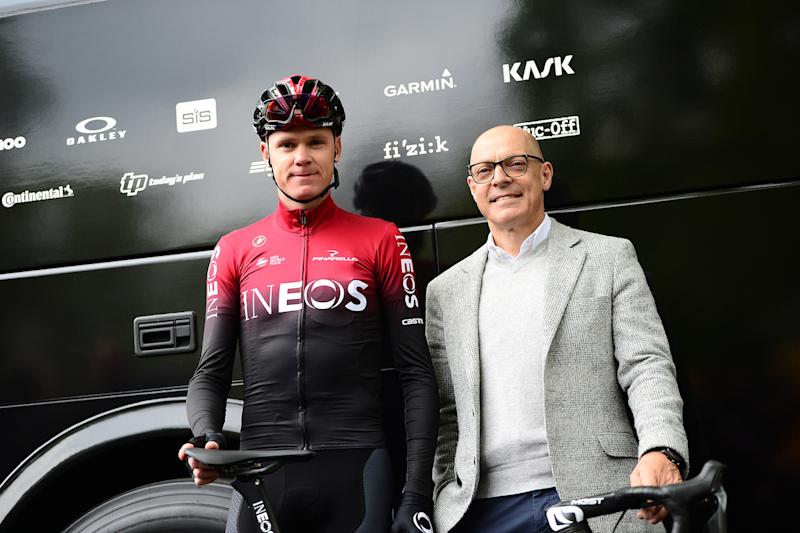 Chris Froome and Dave Brailsford outside the new bus