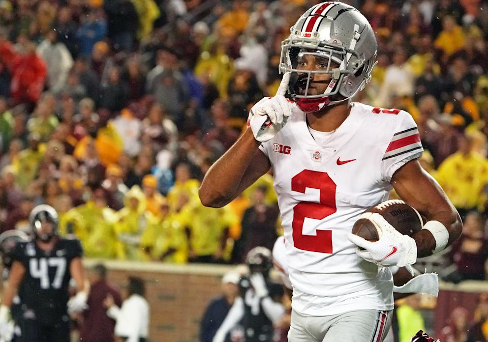 MINNEAPOLIS, MN - SEPTEMBER 02:  Ohio State Buckeyes wide receiver Chris Olave (2) tells the crowd to shhh after a 38-yard touchdown reception during a game between the Minnesota Golden Gophers and the Ohio State Buckeyes at Huntington Bank Stadium in Minneapolis, MN on September 2, 2021.(Photo by Nick Wosika/Icon Sportswire via Getty Images)