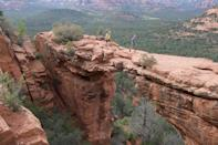 """<p><strong>Devil's Bridge</strong></p><p>Aside from local art shops and neutral architecture that blends in with the red rock landscape, Sedona is home to <a href=""""https://www.fs.usda.gov/recarea/coconino/recarea/?recid=55292"""" rel=""""nofollow noopener"""" target=""""_blank"""" data-ylk=""""slk:Devil's Bridge"""" class=""""link rapid-noclick-resp"""">Devil's Bridge</a>. With a natural bridge formation on this trail, it's no wonder why it's on the top of most hikers' lists. It does get crowded so be sure to get there early if you don't want anyone in your photo.</p>"""