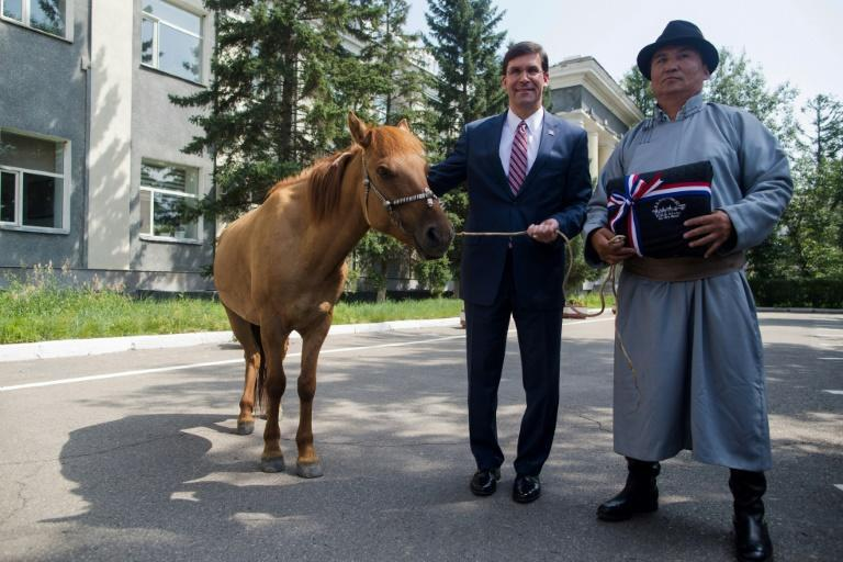 Building new allies: US Secretary of Defense Mark Esper (L) is presented a horse in Ulaanbaatar, Mongolia in August 2019