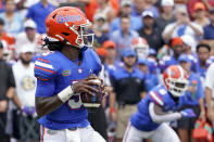 Florida quarterback Emory Jones looks for a receiver during the first half of an NCAA college football game against Alabama, Saturday, Sept. 18, 2021, in Gainesville, Fla. (AP Photo/John Raoux)