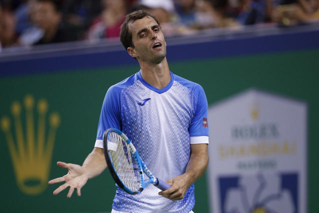 Albert Ramos-Vinolas of Spain reacts as he plays against Roger Federer of Switzerland during the men's singles match at the Shanghai Masters tennis tournament at Qizhong Forest Sports City Tennis Center in Shanghai, China, Tuesday, Oct. 8, 2019. (AP Photo/Andy Wong)