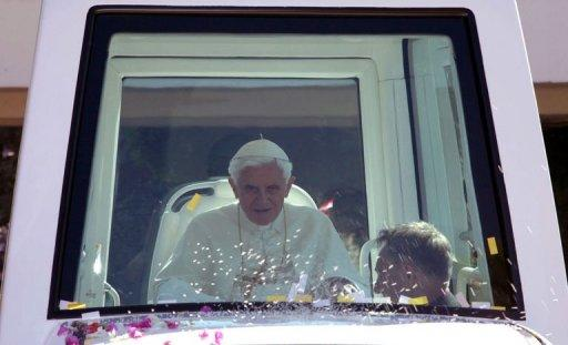 Pope Benedict XVI arrives in his popemobile at the presidential palace of Baabda