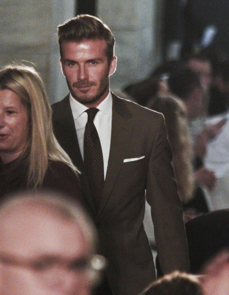 David Beckham arrives at the show for Victoria Beckham's Spring 2013 fashion collection on Sunday, Sept. 9, 2012 in New York. (AP Photo/Bebeto Matthews)