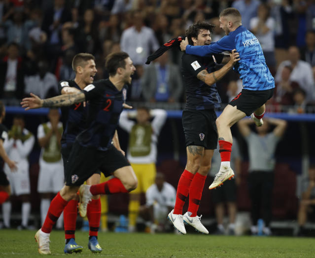 Players of Croatia celebrate after the semifinal match between Croatia and England at the 2018 soccer World Cup in the Luzhniki Stadium in Moscow, Russia, Wednesday, July 11, 2018. (AP Photo/Francisco Seco)