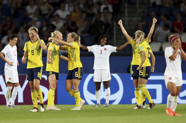 Team Sweden, left, celebrates after winning their Women's World Cup round of 16 soccer match between Canada and Sweden at Parc des Princes in Paris, France, Monday, June 24, 2019. (AP Photo/Francisco Seco)
