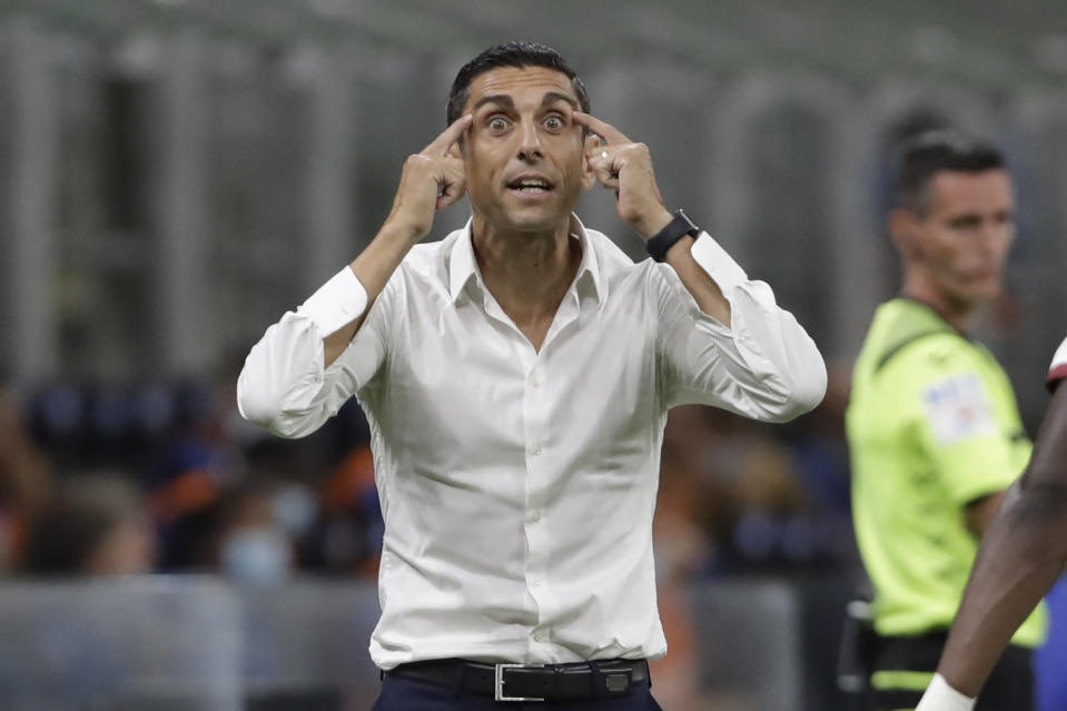 Torino's head coach Moreno Longo reacts during a Serie A soccer match between Inter Milan and Torino, at the San Siro stadium in Milan, Italy, Monday, July 13, 2020. (AP Photo/Luca Bruno