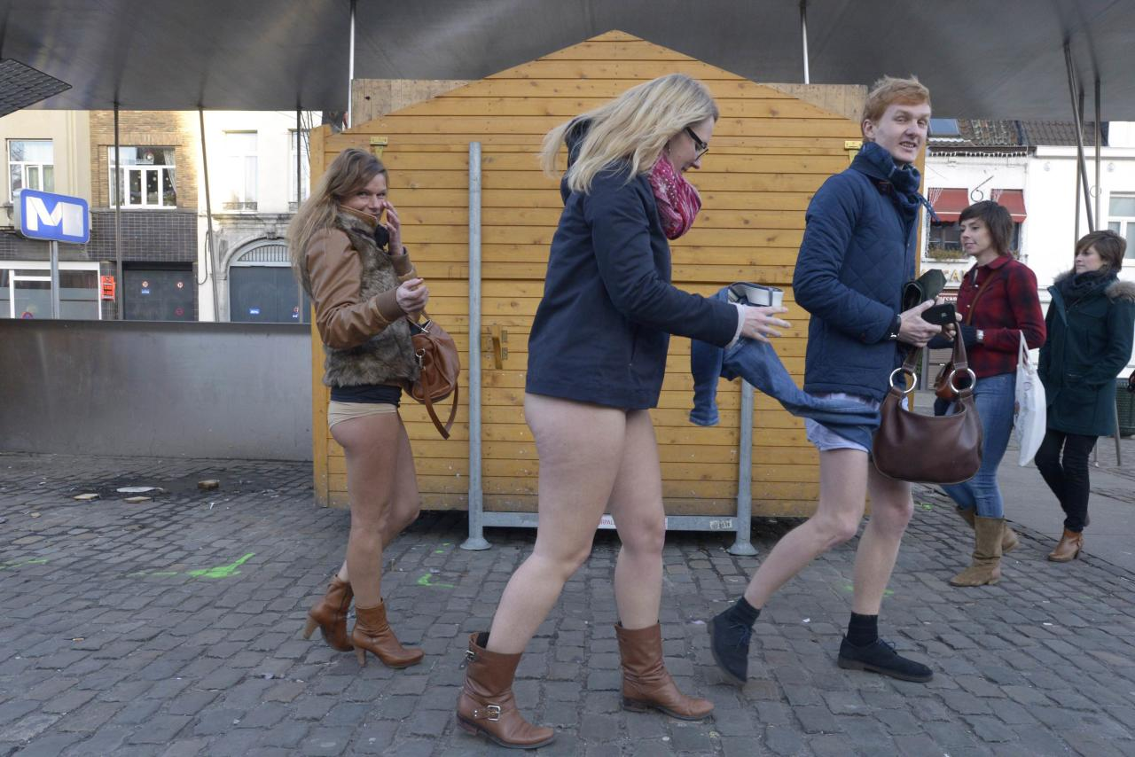 "People take part in the annual ""No Pants Subway Ride"" celebrations on the streets of Brussels January 12, 2014. The event involves participants who strip down to their underwear as they go about their normal routine, and occurs in different cities around the world in January, according to its organisers. REUTERS/Eric Vidal (BELGIUM - Tags: TRANSPORT SOCIETY ANNIVERSARY)"