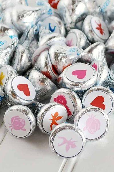 """<p> Place stickers on the bottom of a Hershey's Kiss (or similar candy), mix them up, arrange them in a grid and see if you can find a pair. Whoever makes the match gets to keep the chocolate! </p><p><em><a href=""""https://www.creationsbykara.com/valentines-day-matching-game-free-printable/"""" rel=""""nofollow noopener"""" target=""""_blank"""" data-ylk=""""slk:Get the tutorial at Creations by Kara »"""" class=""""link rapid-noclick-resp"""">Get the tutorial at Creations by Kara »</a></em></p>"""