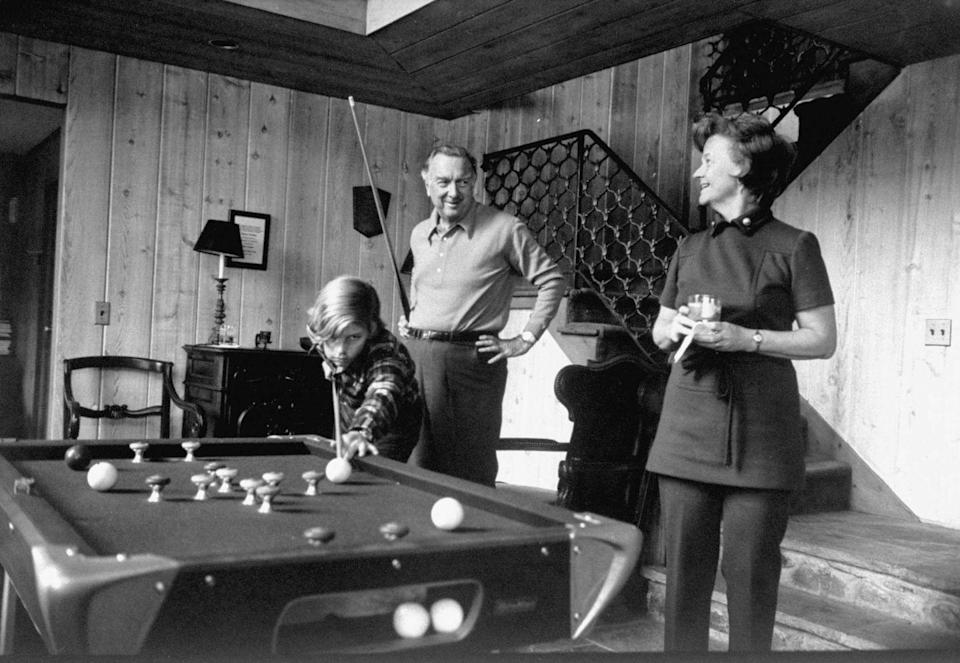 <p>Walter Cronkite plays pool with his wife, Betsy, and son, Chip, at home in 1971.</p>