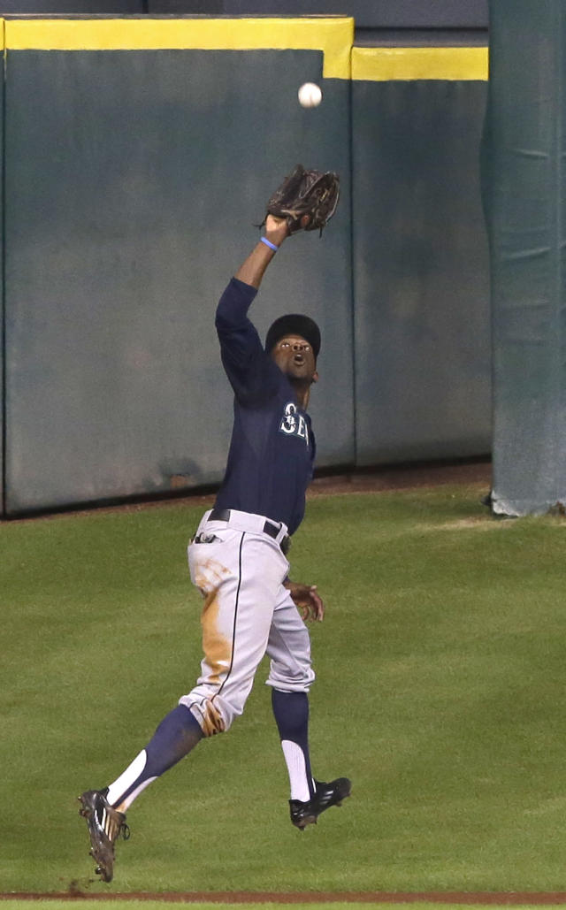 Seattle Mariners center fielder James Jones makes the catch and the out on Houston Astros' George Springer in the third inning of a baseball game Tuesday, July 1, 2014, in Houston. (AP Photo/Pat Sullivan)