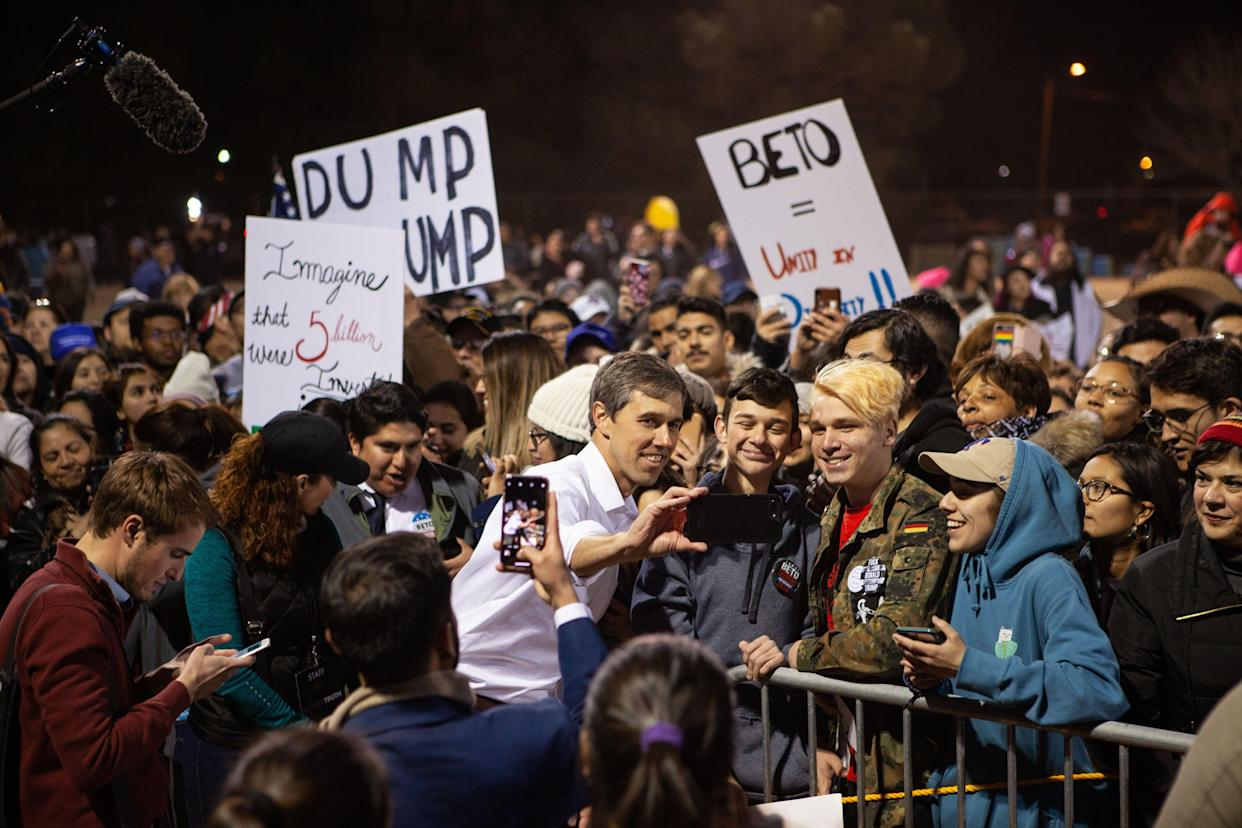 O'Rourke takes selfies with supporters at the rally. (Photo: Christ Chavez/Getty Images)