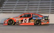 Sprint Cup Series driver Tony Stewart (14) drives through Turn 4 during the Texas 500 qualifying at Texas Motor Speedway in Fort Worth, Texas, Friday, Oct. 31, 2014. Stewart had NASCAR's first 200-mph qualifying lap on an intermediate track. (AP Photo/Larry Papke )