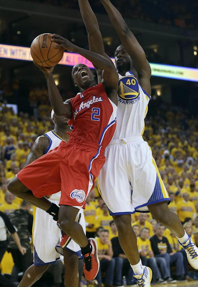 Los Angeles Clippers guard Darren Collison (2) shoots against Golden State Warriors forward Harrison Barnes (40) during the first half of Game 6 of an opening-round NBA basketball playoff series in Oakland, Calif., Thursday, May 1, 2014. (AP Photo/Marcio Jose Sanchez)