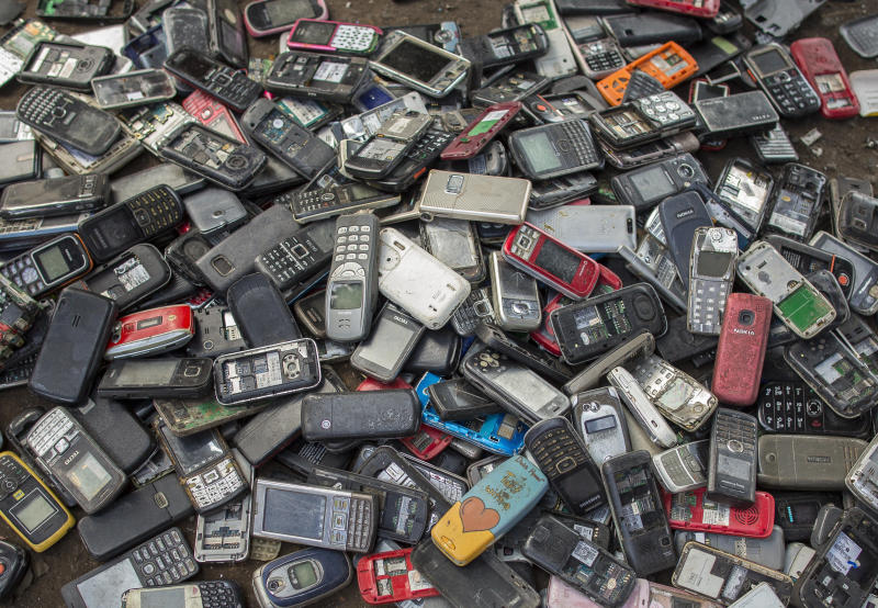 """Old mobile phones piled up at a scrapyard in Ghana's capital city, Accra. Last year, Apple alone sold <a href=""""https://www.statista.com/statistics/276306/global-apple-iphone-sales-since-fiscal-year-2007/"""" target=""""_blank"""" rel=""""noopener noreferrer"""">more than 217 million iPhones</a>."""