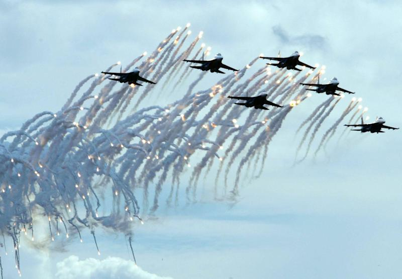 Pilots of the Russian Warriors air force aerobatic squadron fly their Su-27s and fire flares during a demonstration flight at the Moscow International Air Show: Oleg Nikishin/Getty Images