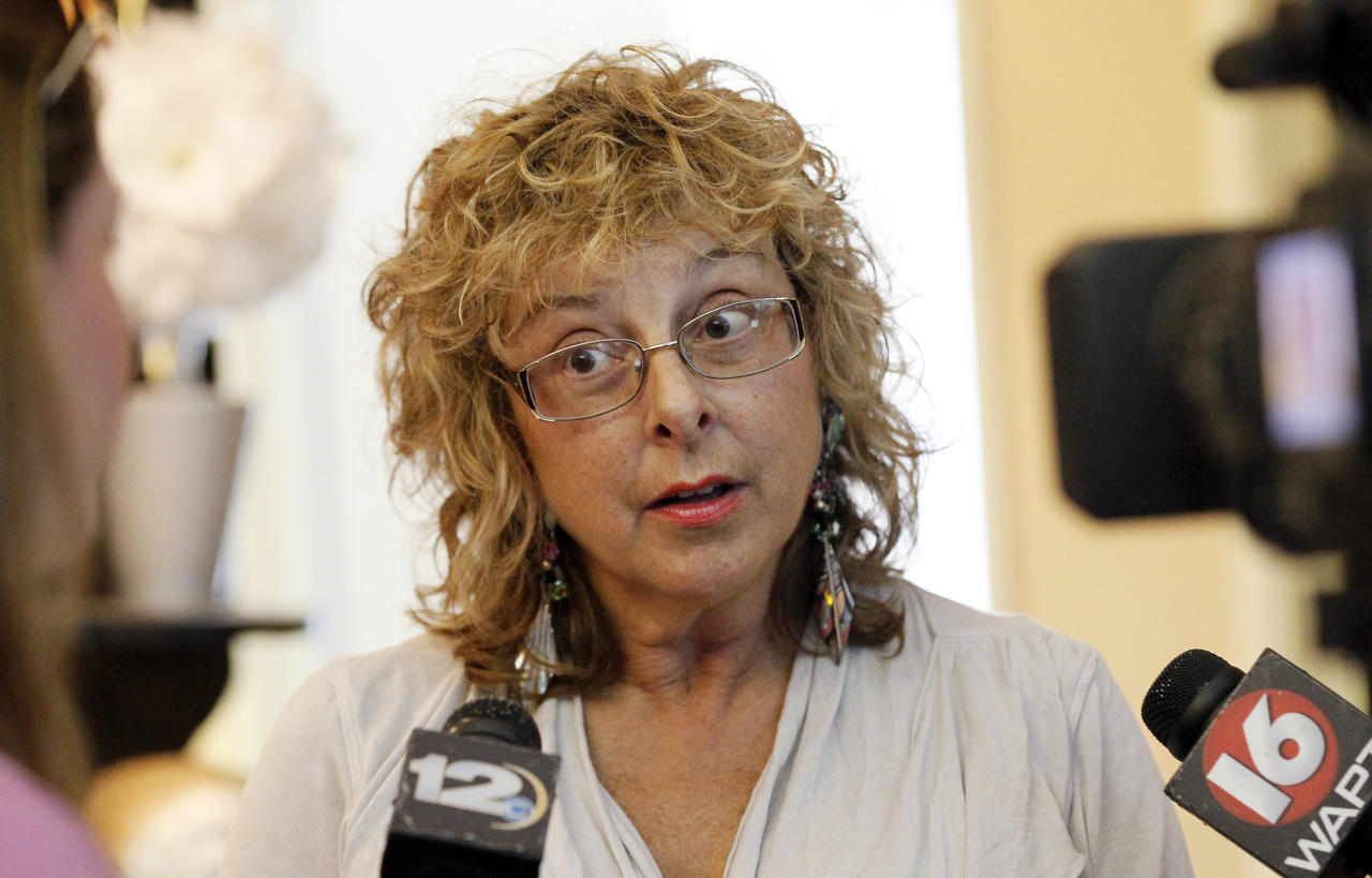 """Jackson Women's Health Organization owner Diane Derzis, tells reporters that is is """"business as usual,"""" for Mississippi's only abortion clinic in Jackson, Miss., Monday, July 2, 2012, after a federal judge issued a temporary restraining order Sunday, that blocked enforcement of a law that could regulate it out of business. The law would require any physician doing abortions at the clinic to be an OB-GYN with privileges to admit patients to a local hospital. (AP Photo/Rogelio V. Solis)"""