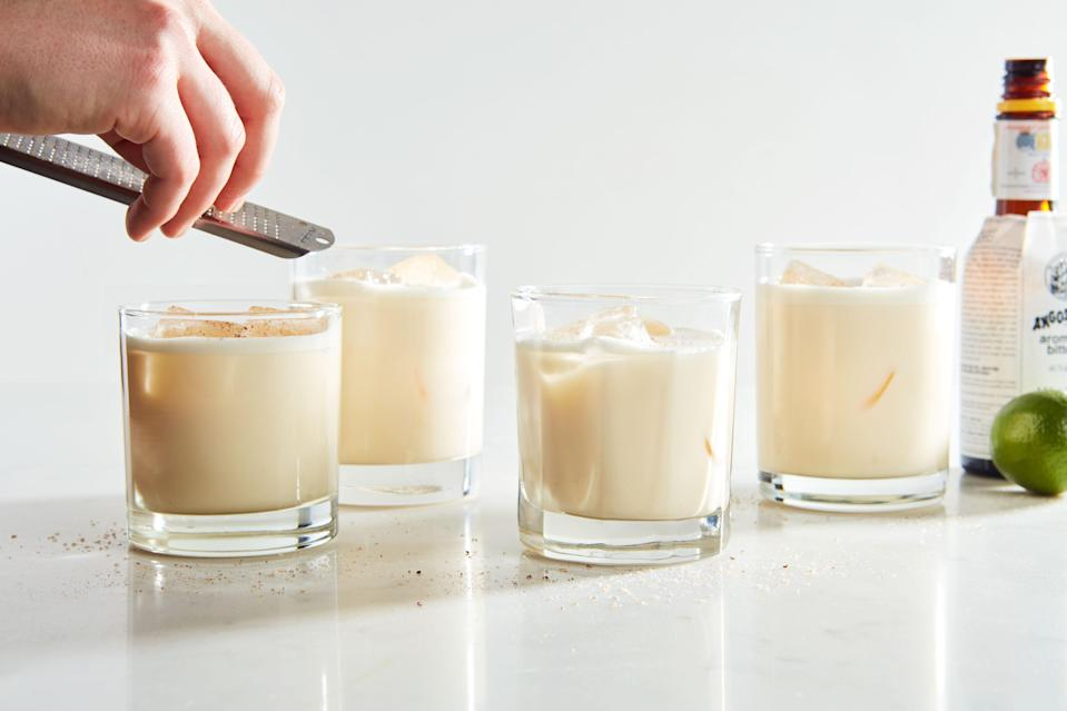 """Even if you don't like eggnog, you'll love this potent, aromatic drink, a <a href=""""https://www.epicurious.com/holidays-events/ponche-a-creme-trinidad-christmas-eggnog-rum-cocktail-article?mbid=synd_yahoo_rss"""" rel=""""nofollow noopener"""" target=""""_blank"""" data-ylk=""""slk:Trinidadian Christmas tradition"""" class=""""link rapid-noclick-resp"""">Trinidadian Christmas tradition</a>. It's made with loads of lime zest, freshly grated nutmeg, Angostura bitters, and a mix of evaporated and sweetened condensed milk, plus eggs and white rum. <a href=""""https://www.epicurious.com/recipes/food/views/ponche-a-crema?mbid=synd_yahoo_rss"""" rel=""""nofollow noopener"""" target=""""_blank"""" data-ylk=""""slk:See recipe."""" class=""""link rapid-noclick-resp"""">See recipe.</a>"""